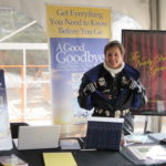 Gail at her booth at Frozen Dead Guy Days