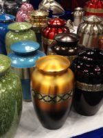 Metal urns of different colors