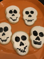 Skull cookies on pumpkin tray